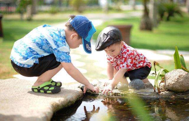 children playing in water in garden