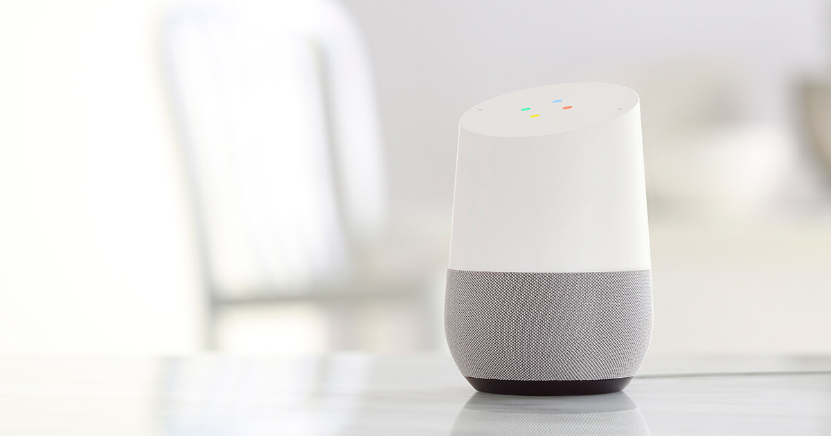 Google Home sits on a table in a bright and modern home